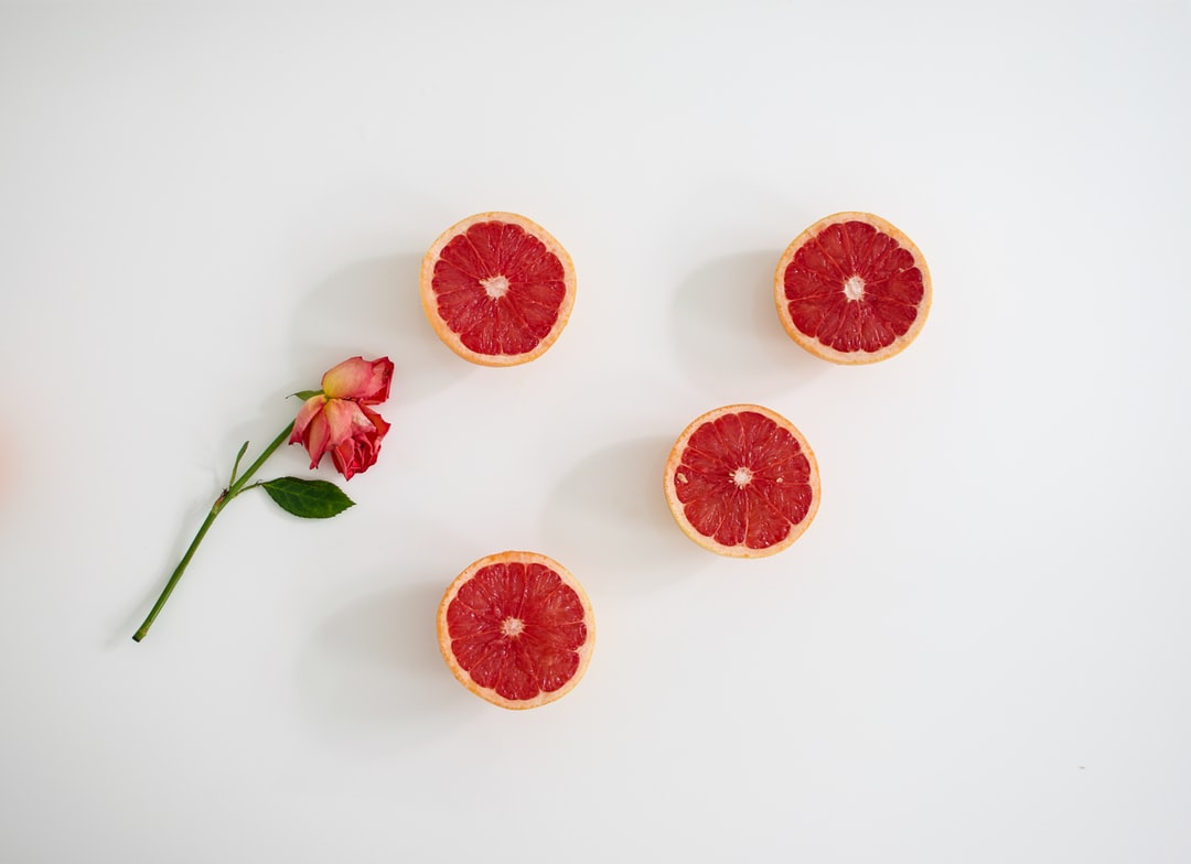 Orange Fruits On White Surface - unsplash