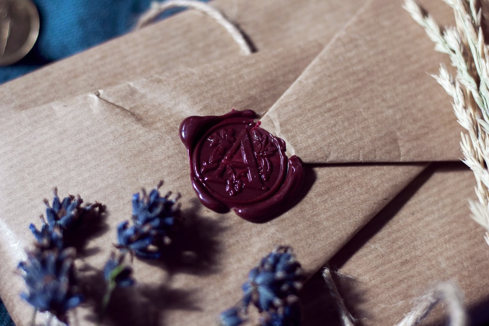 blue flower on brown wooden table