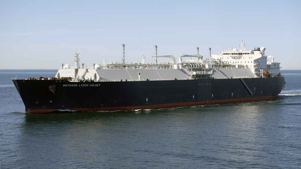 black and brown ship on sea during daytime