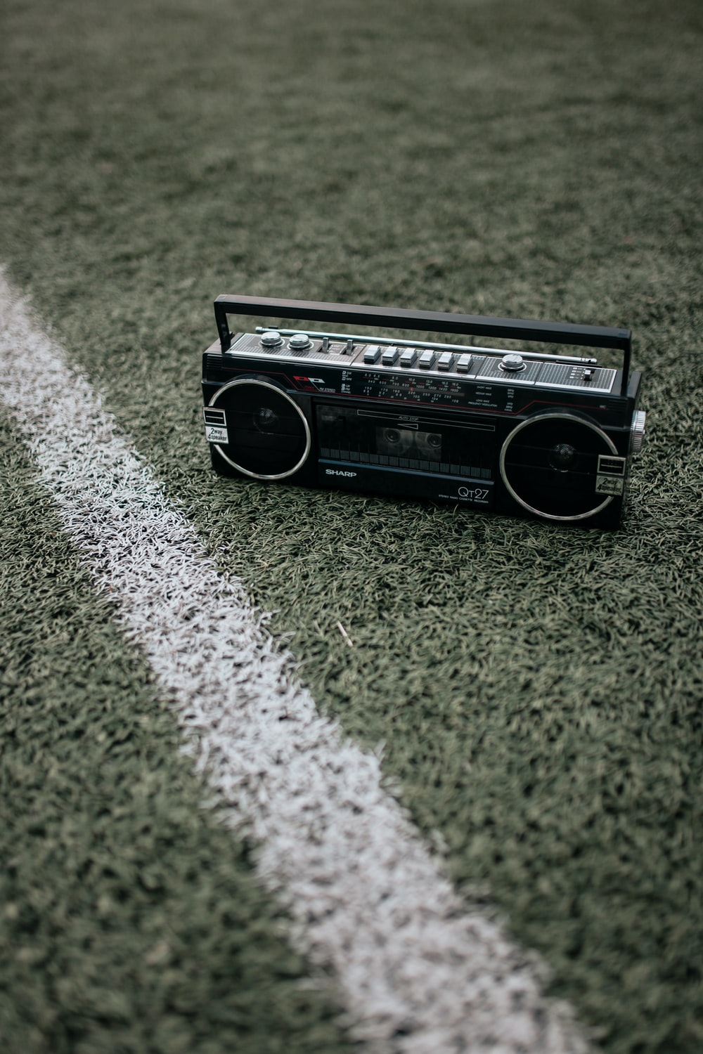 black and gray radio on green grass field