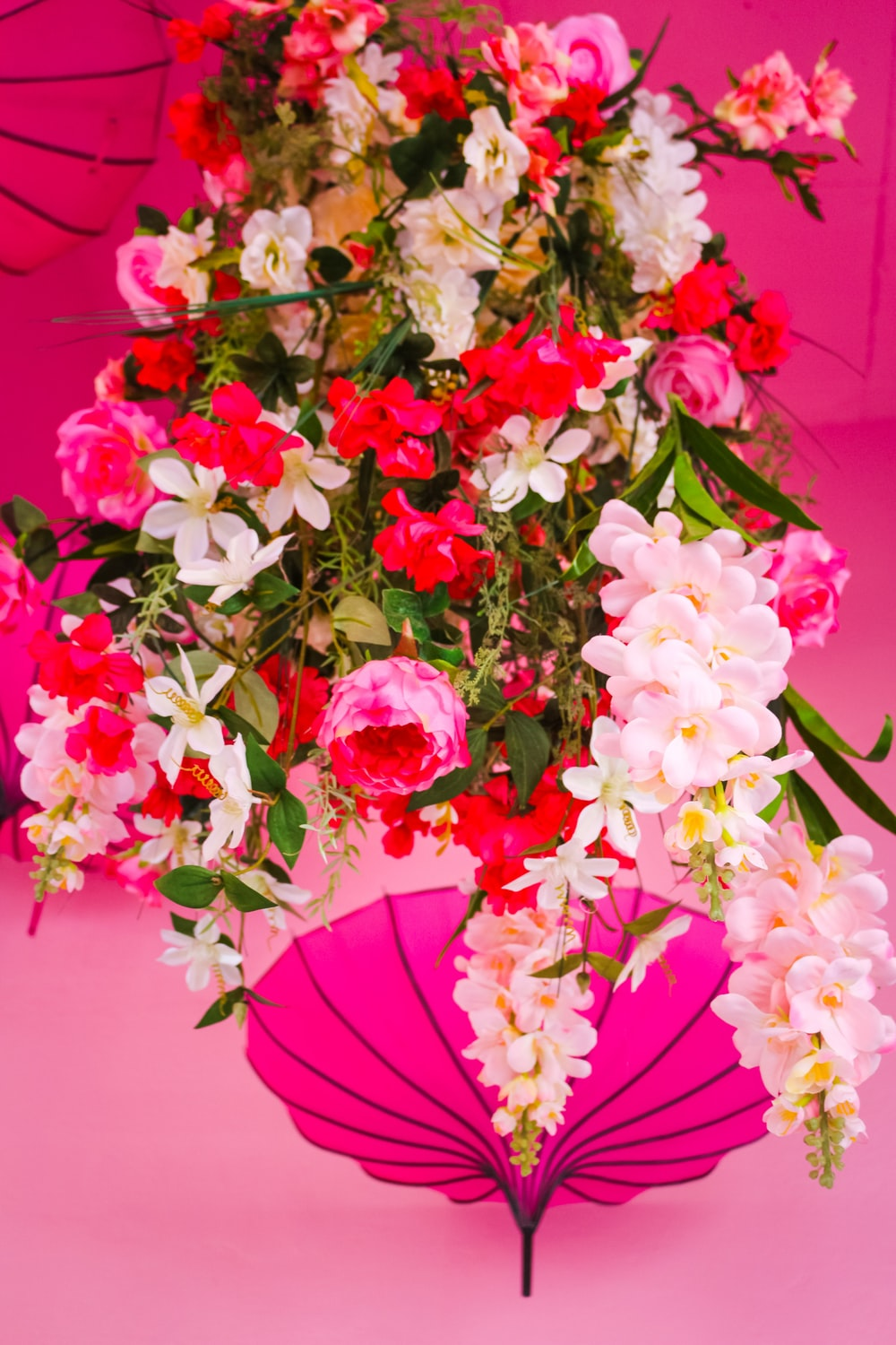 pink and white flowers on red table