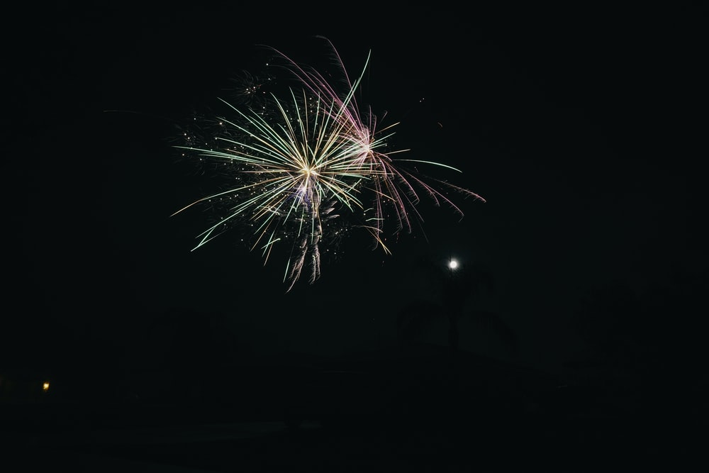 yellow and red fireworks during nighttime