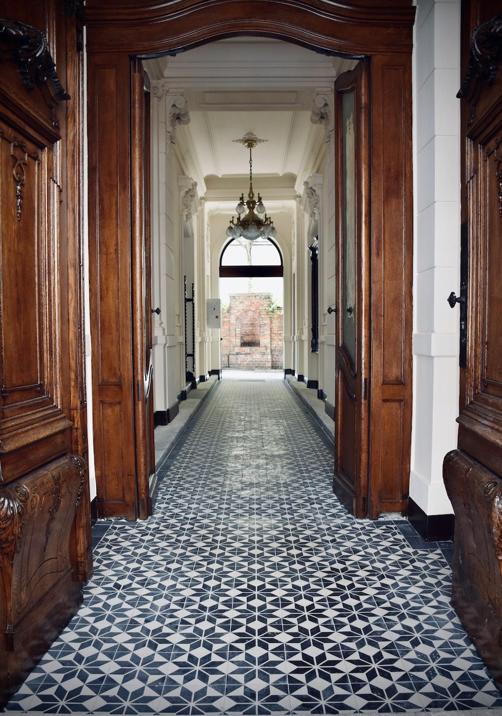 brown wooden door on hallway