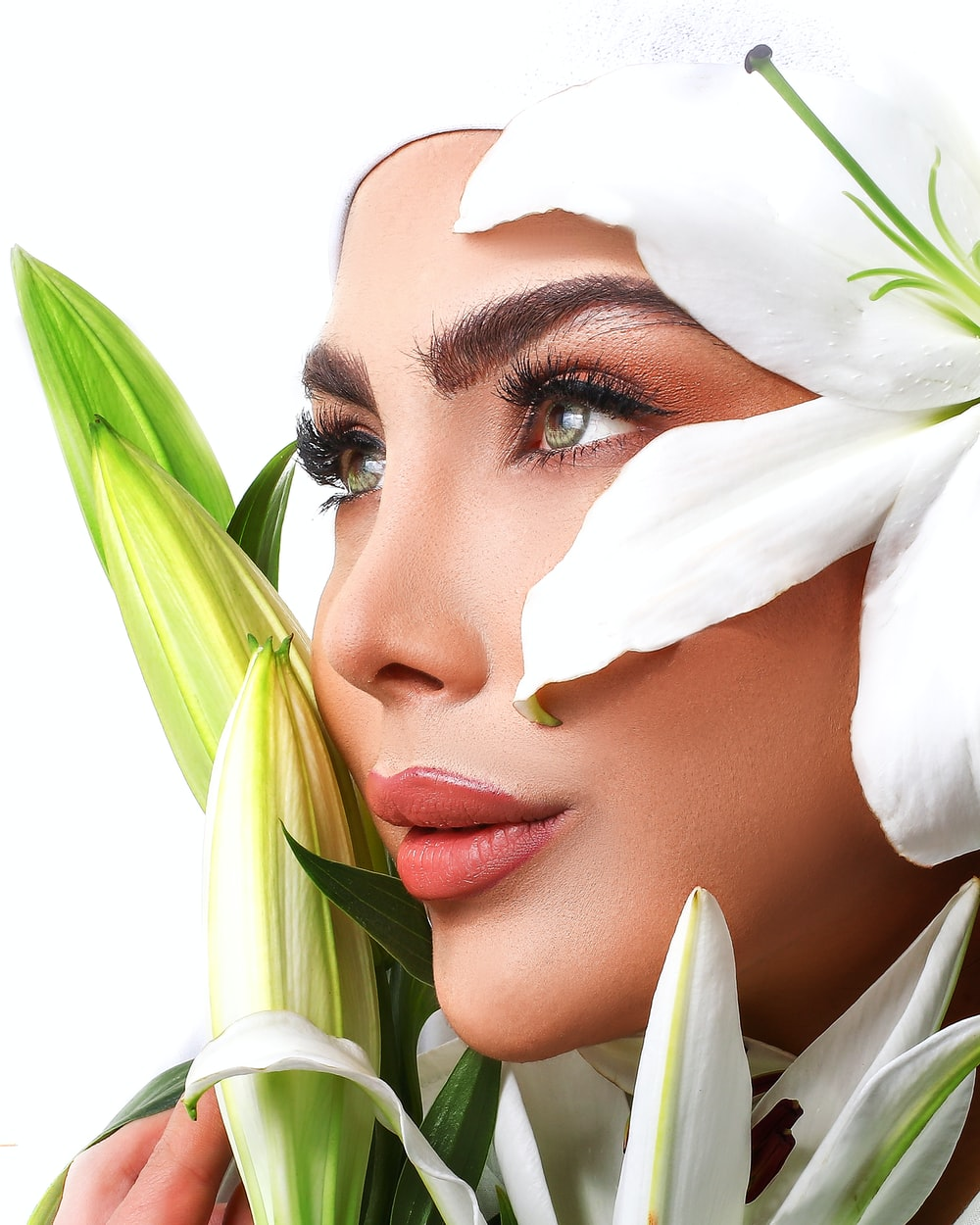 woman with white flower on her face