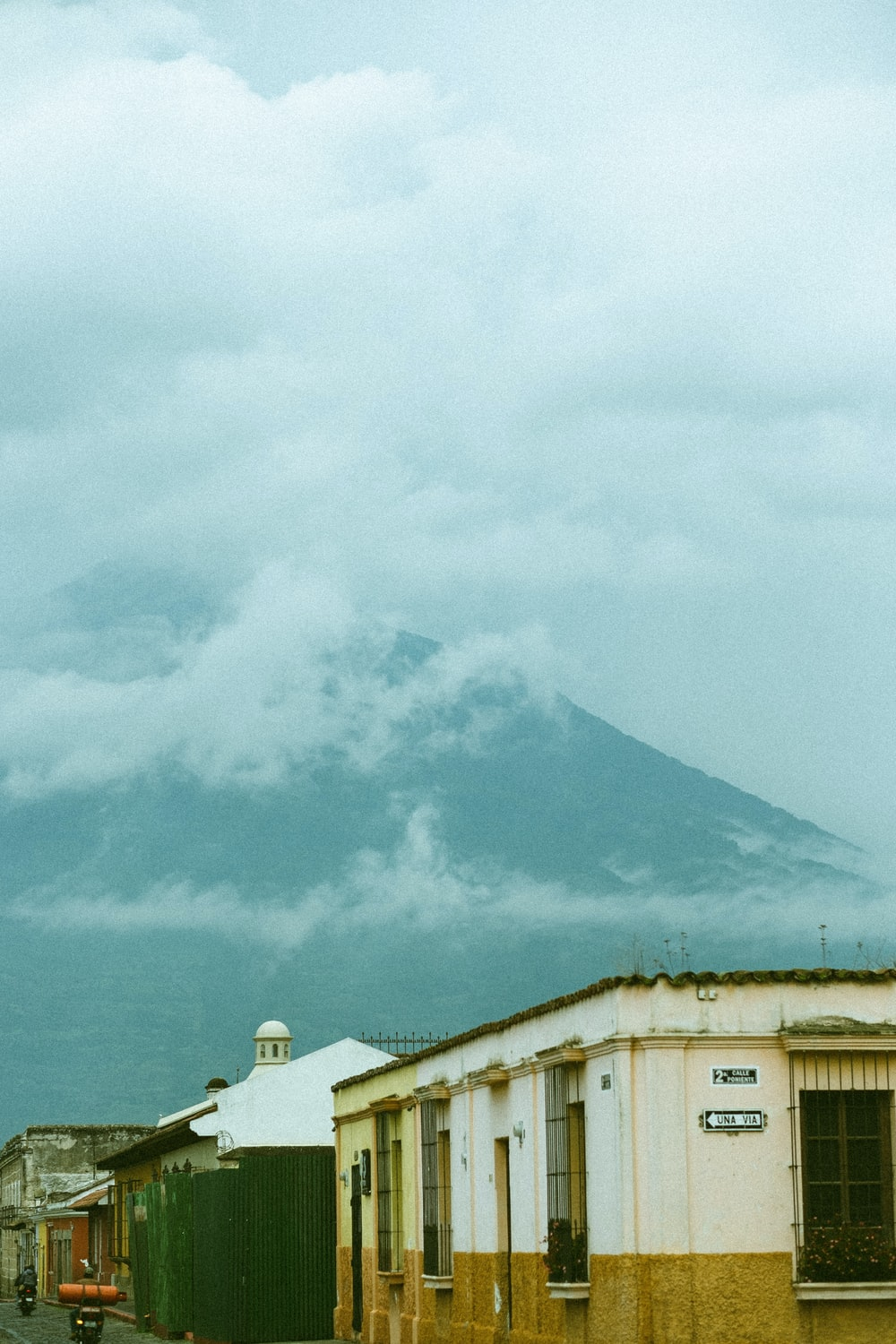 white and black mountain under white clouds during daytime