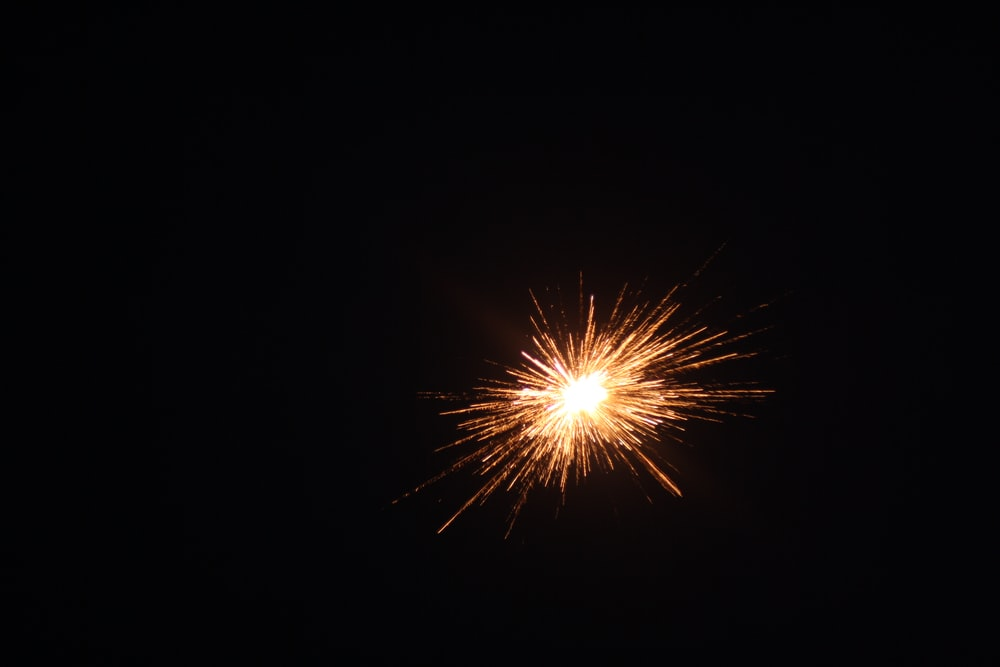 yellow fireworks in the sky during night time