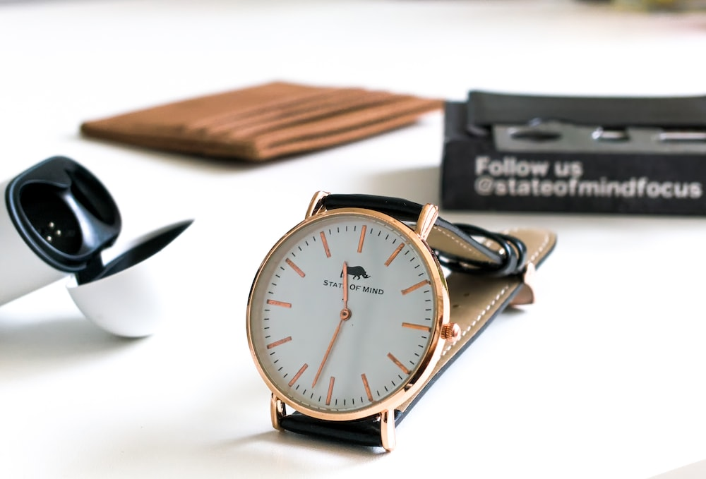 silver and gold round analog watch