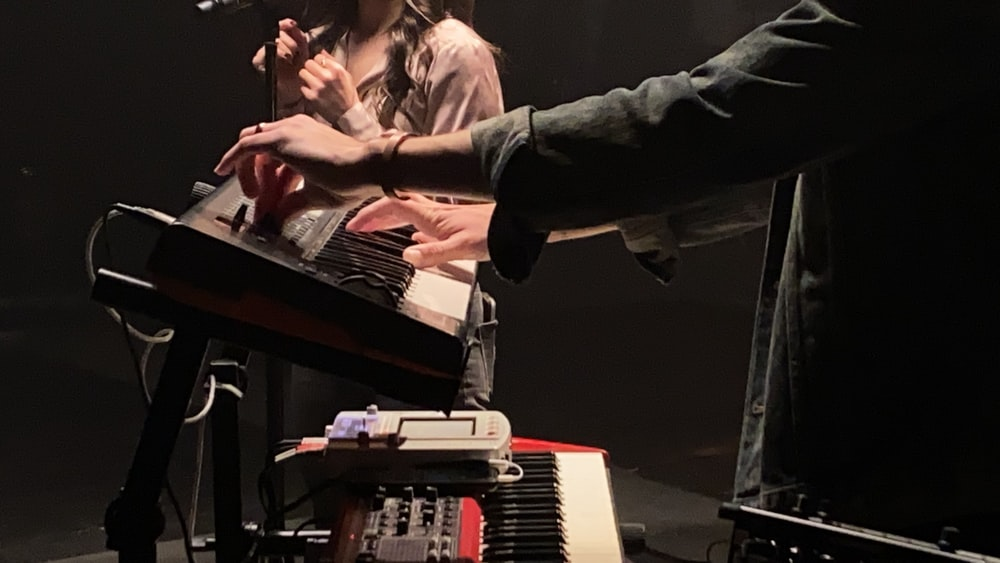 man in black jacket playing piano