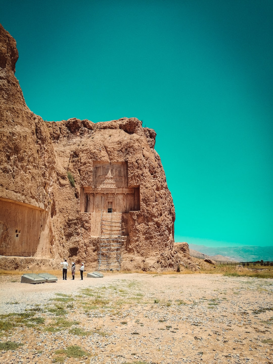Naqsh-e Rostam is an ancient necropolis located about 12 km northwest of Persepolis, in Fars Province, Iran, with a group of ancient Iranian rock reliefs cut into the cliff, from both the Achaemenid and Sassanid periods.