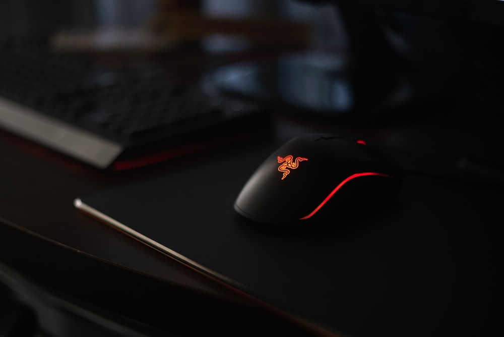 black and red logitech corded computer mouse