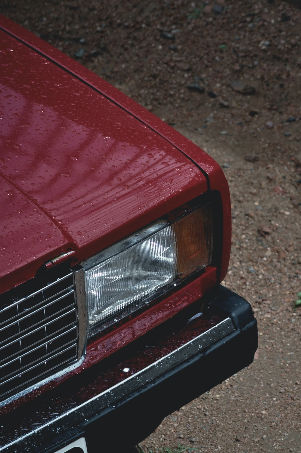 red car on brown soil