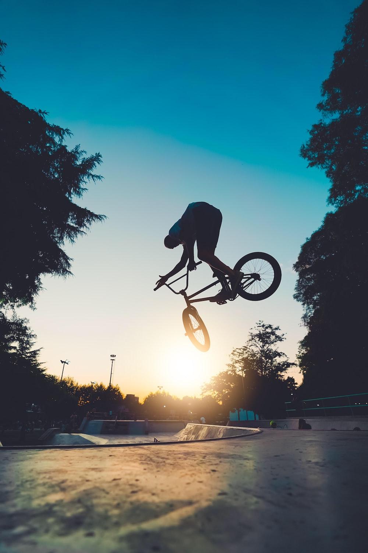 man riding on bicycle on road during daytime