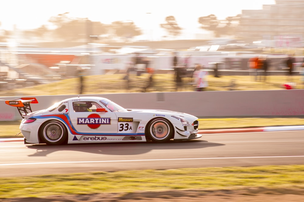 white and red porsche 911 on track
