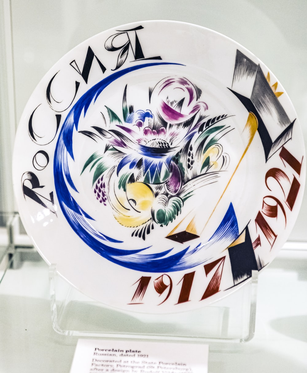 white blue and red floral ceramic plate