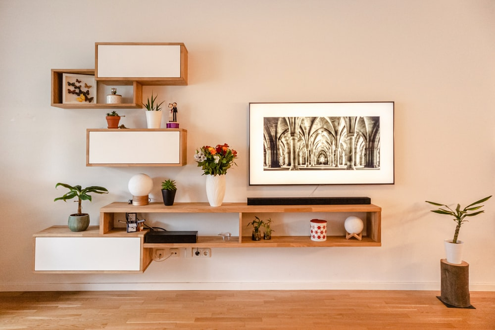 white wooden wall mounted shelf with white wooden frame