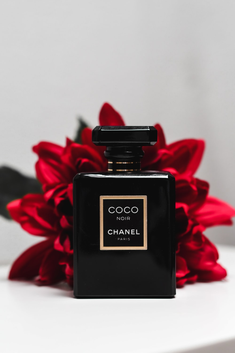 black and gold perfume bottle