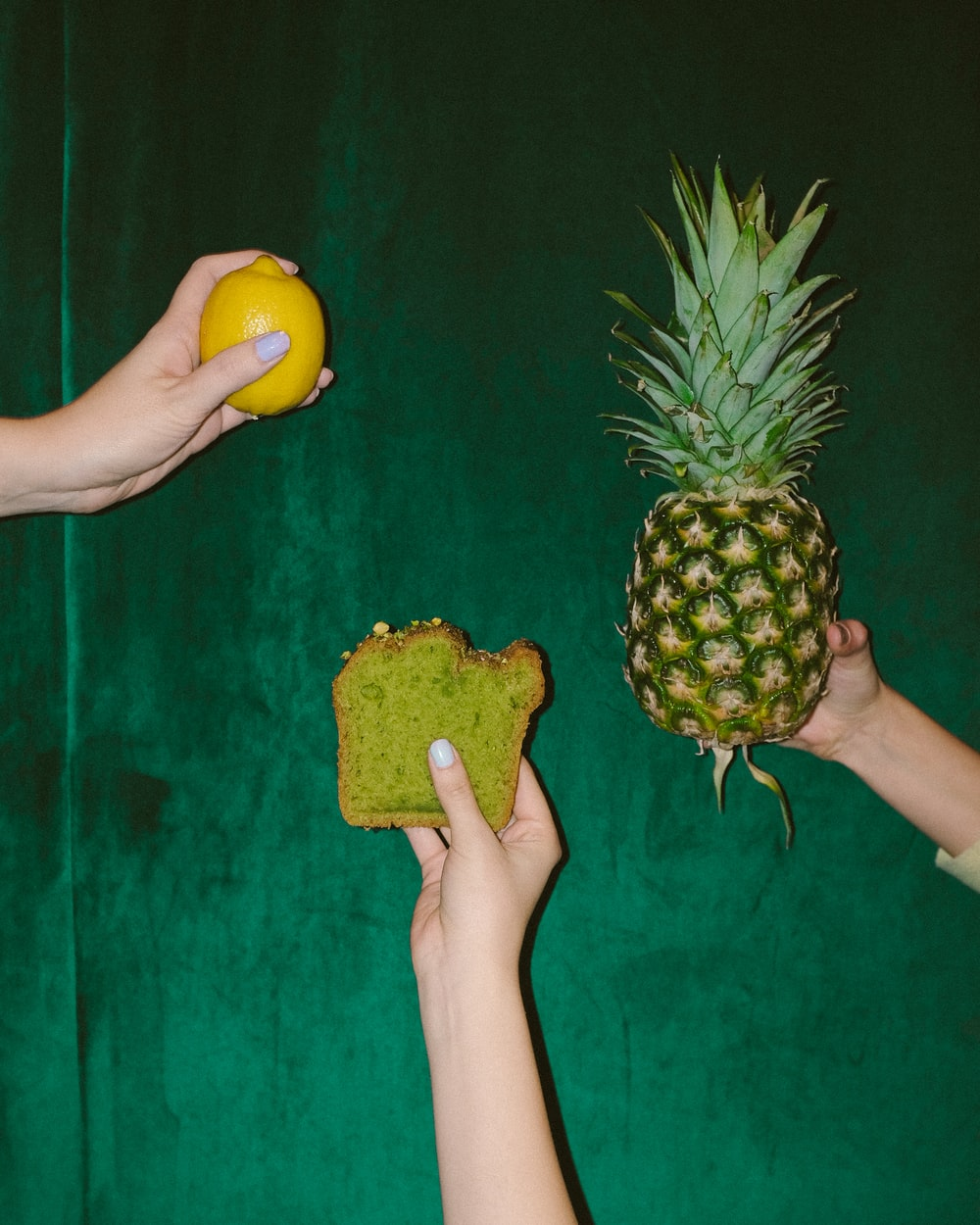 person holding pineapple fruit and pineapple fruit