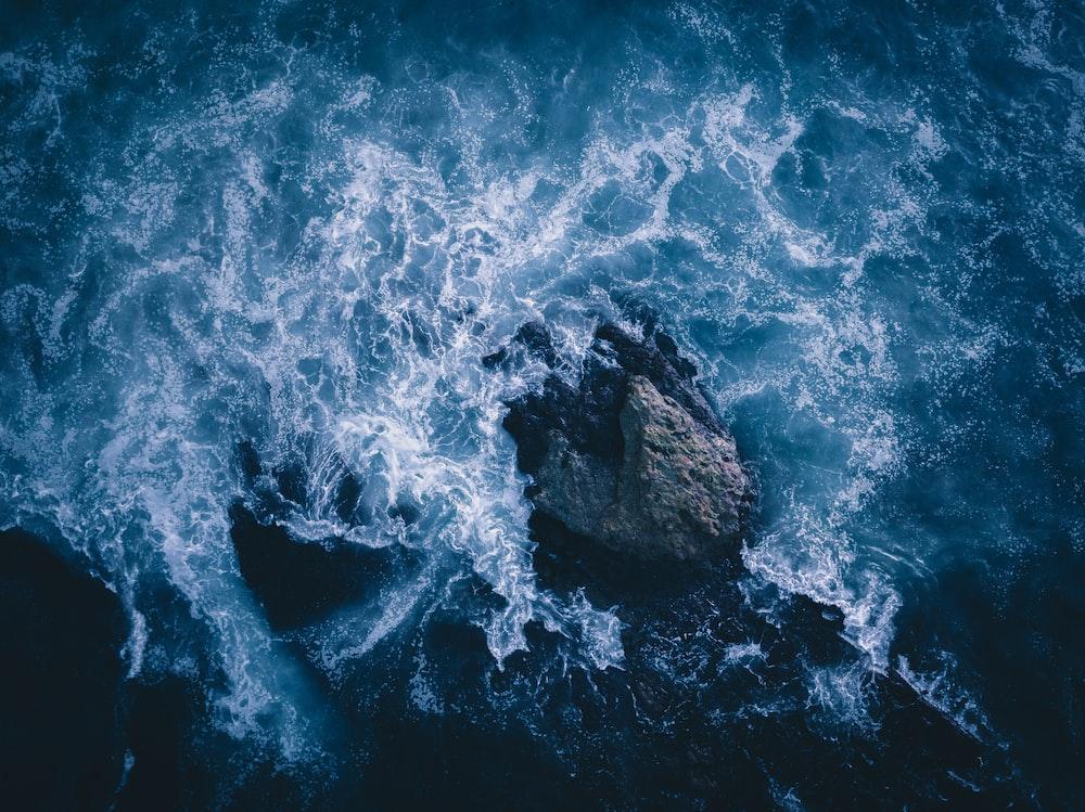 water waves on blue ocean water during daytime