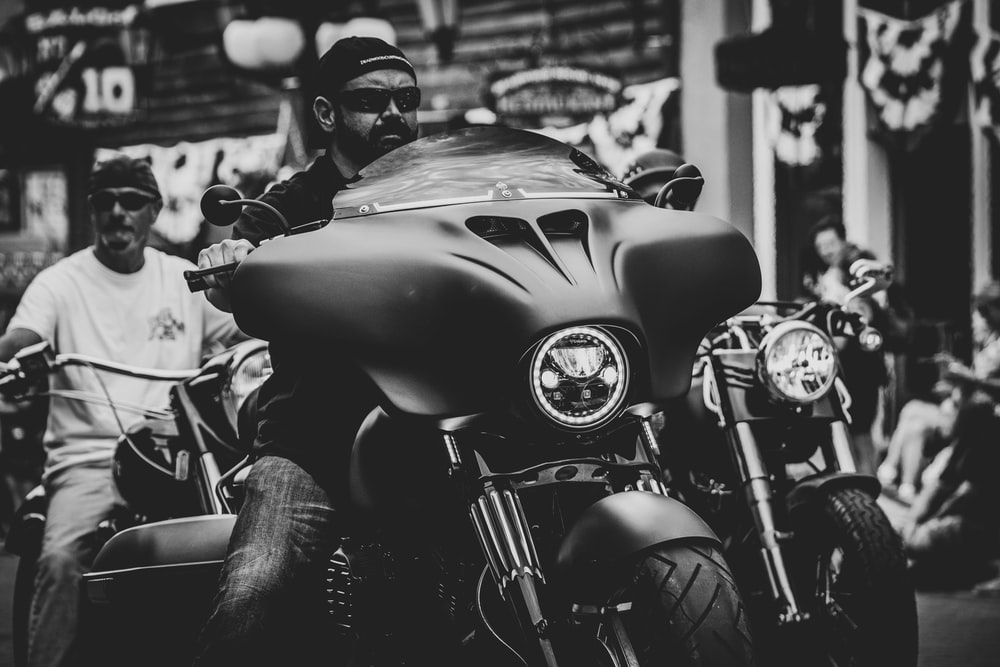 grayscale photo of motorcycle with helmet
