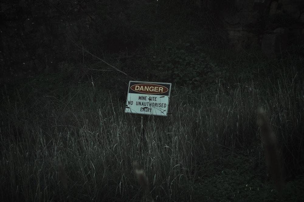 white and black no smoking sign