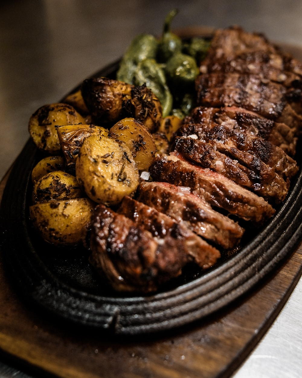 grilled meat on black ceramic plate