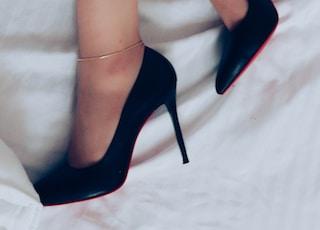 woman wearing black peep toe heeled shoes