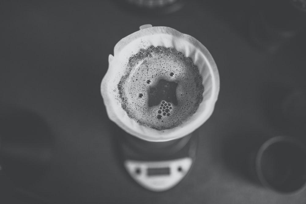 white ceramic cup with black liquid