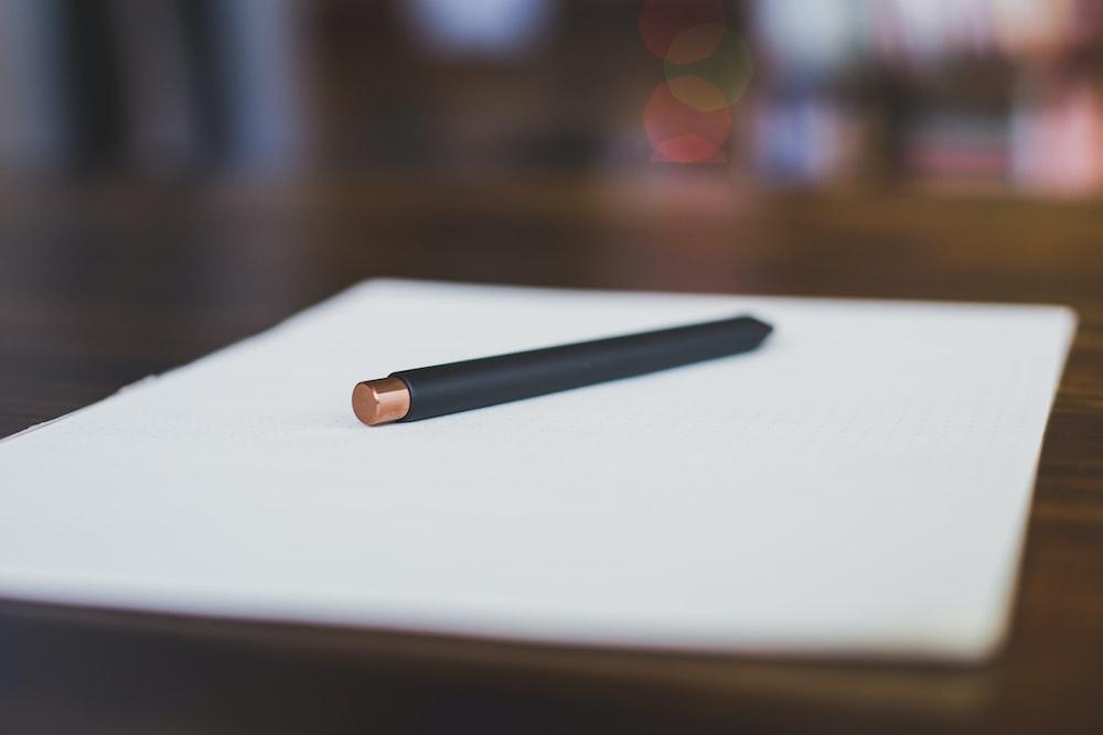 black pen on white paper