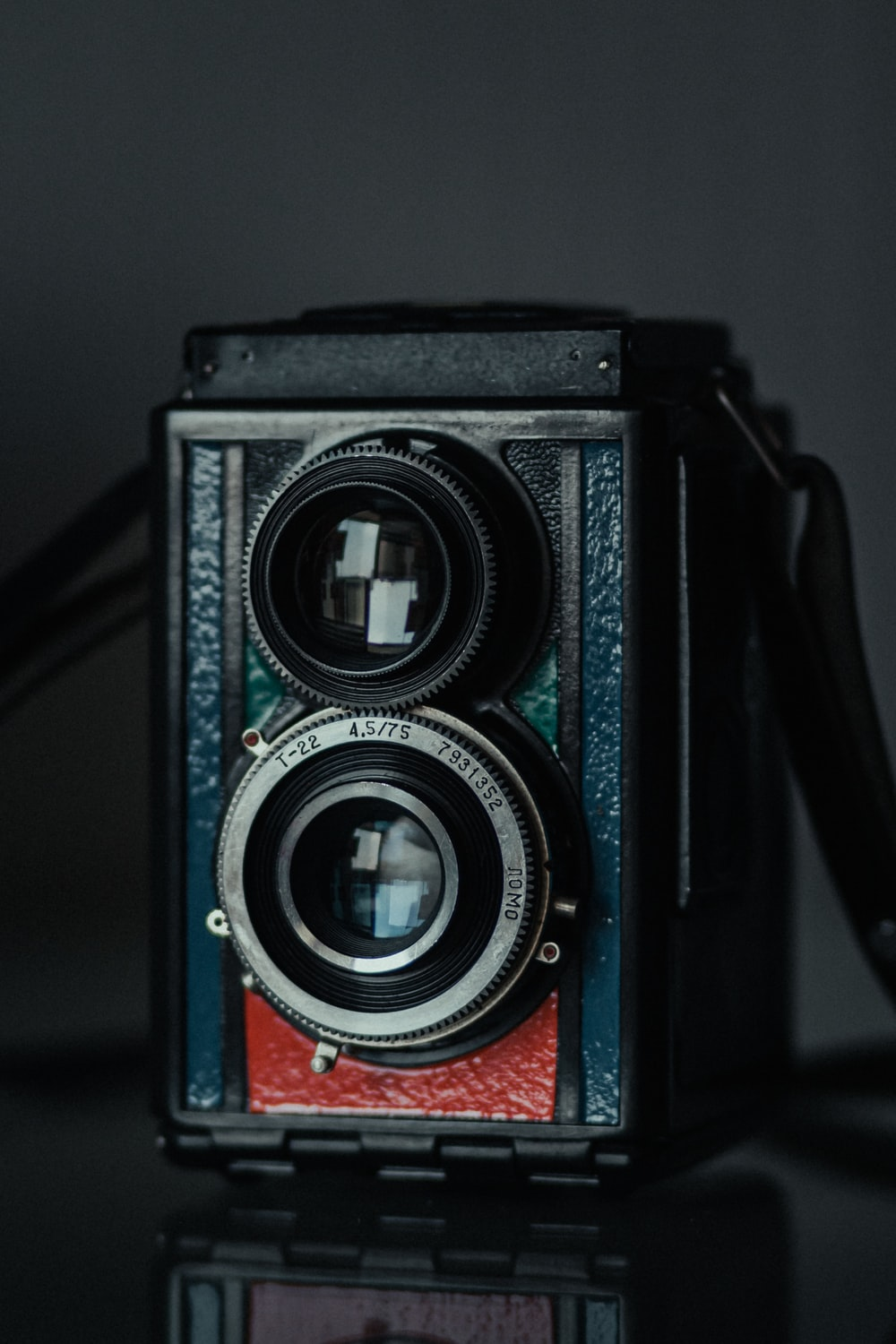 black and red camera on white table