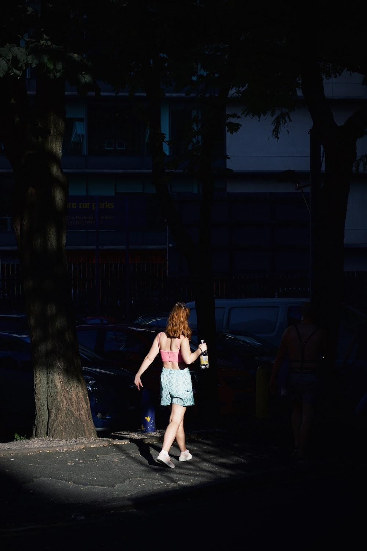 girl in white dress standing on gray concrete floor