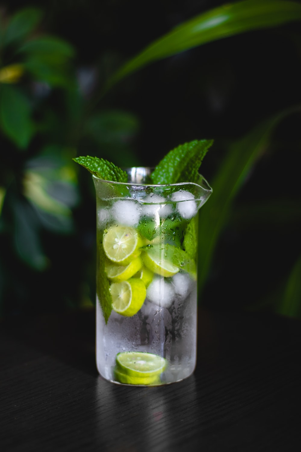 clear drinking glass with green fruit