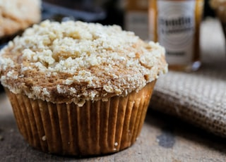brown cupcake with white powder on top