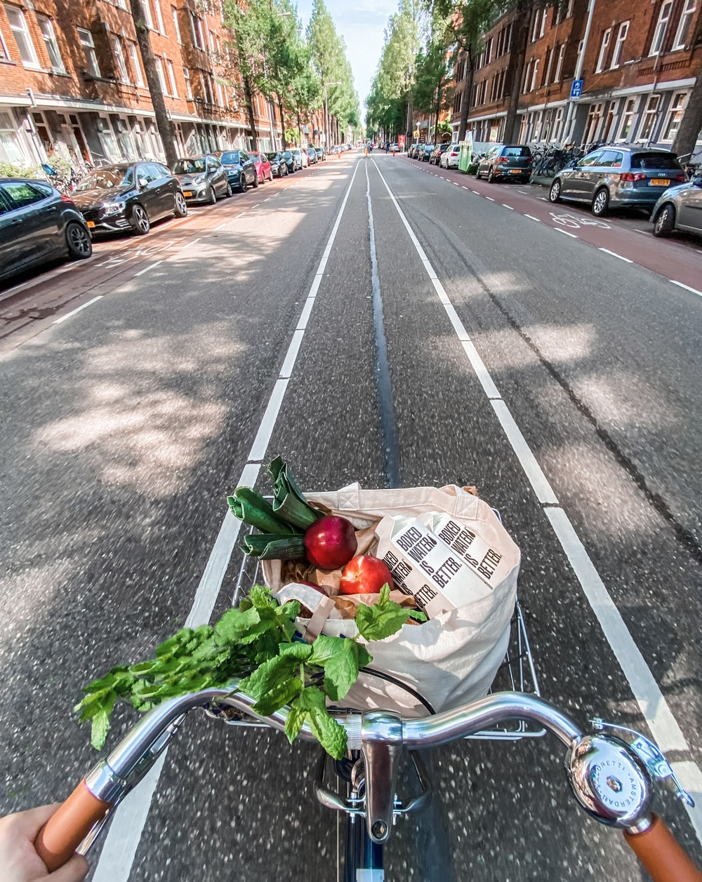 red roses in brown cardboard box on bicycle