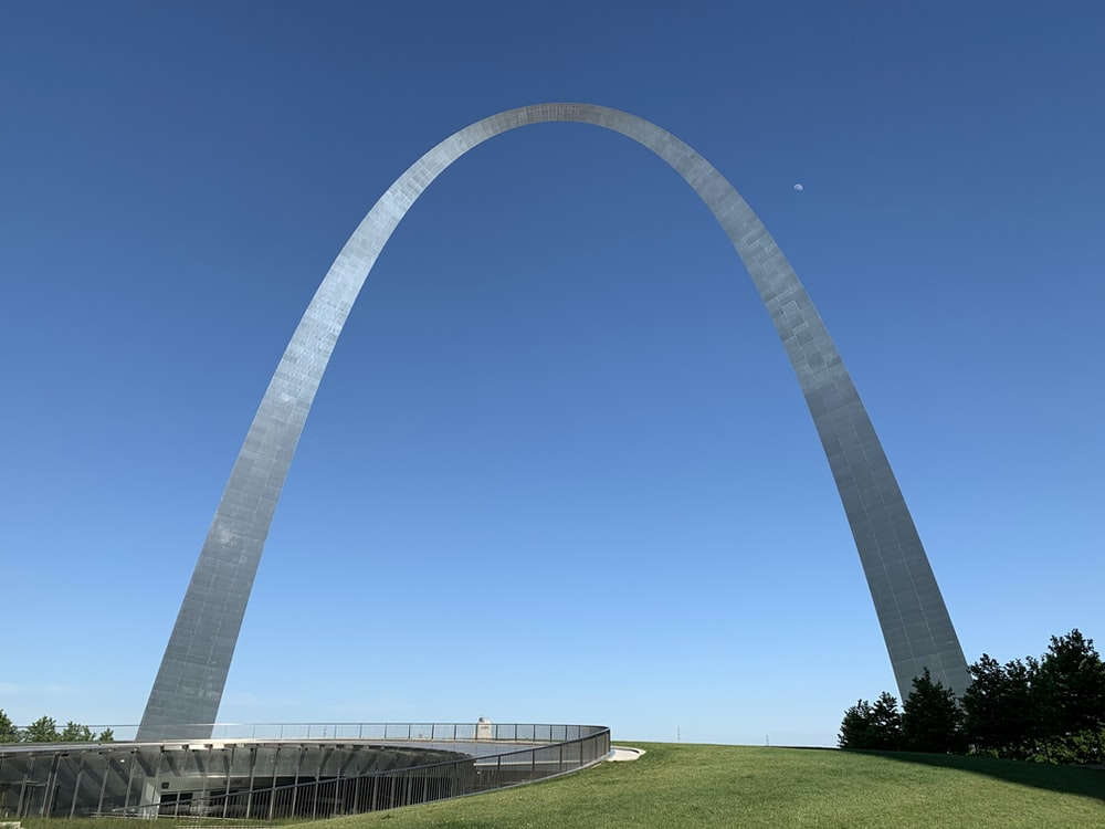 white metal arch under blue sky during daytime