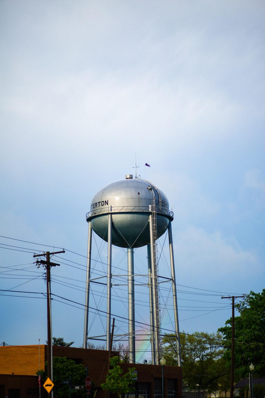 white water tank under white clouds