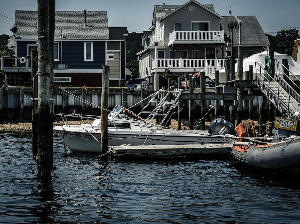 white and orange boat on dock during daytime