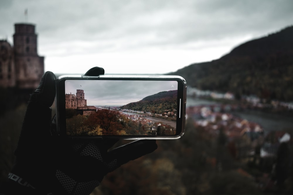black smartphone taking photo of mountain during daytime