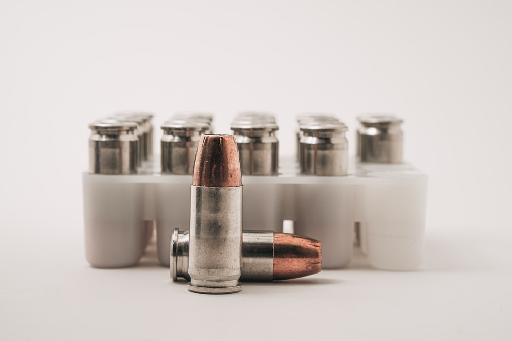 white and brown bottles on white table