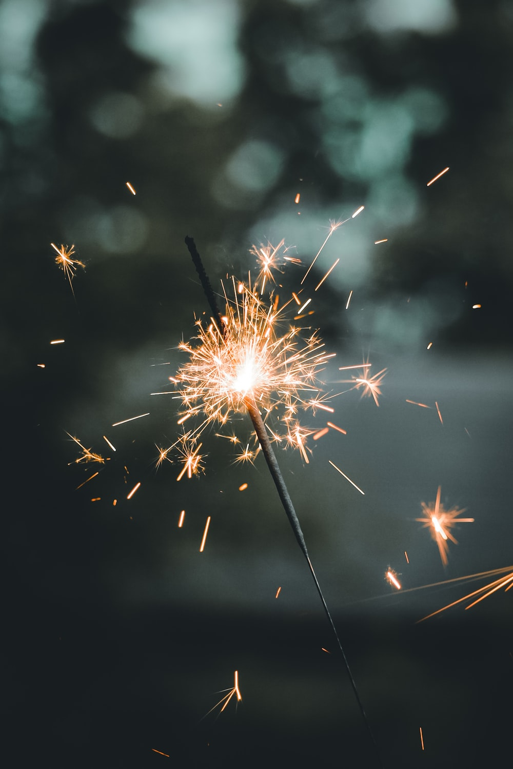 white and brown fireworks in the sky