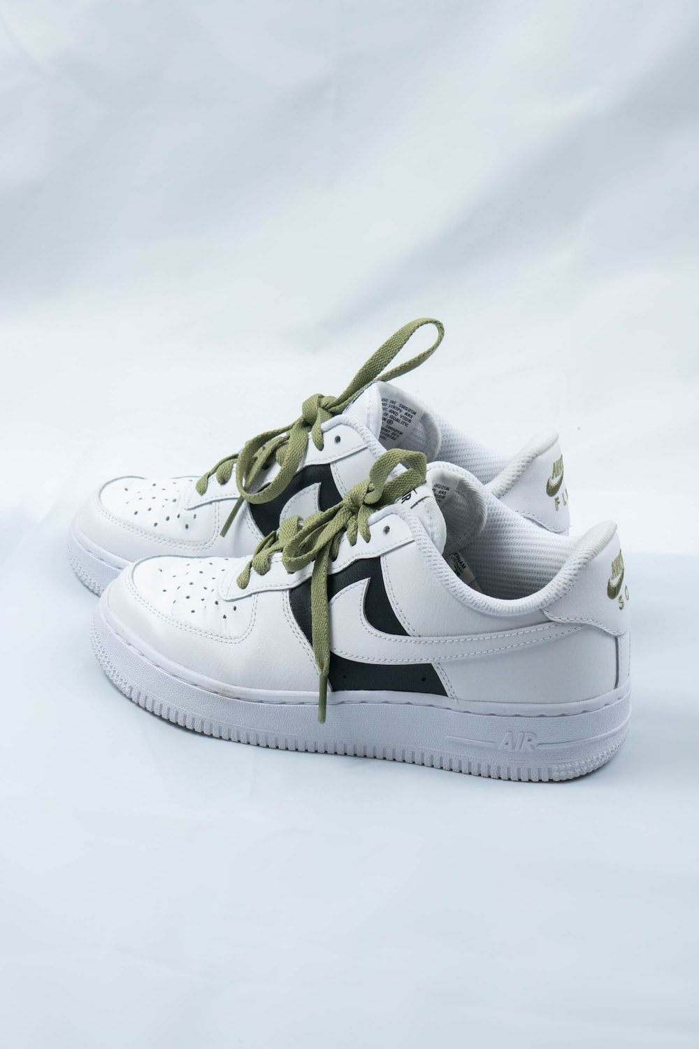 white and gold nike athletic shoes