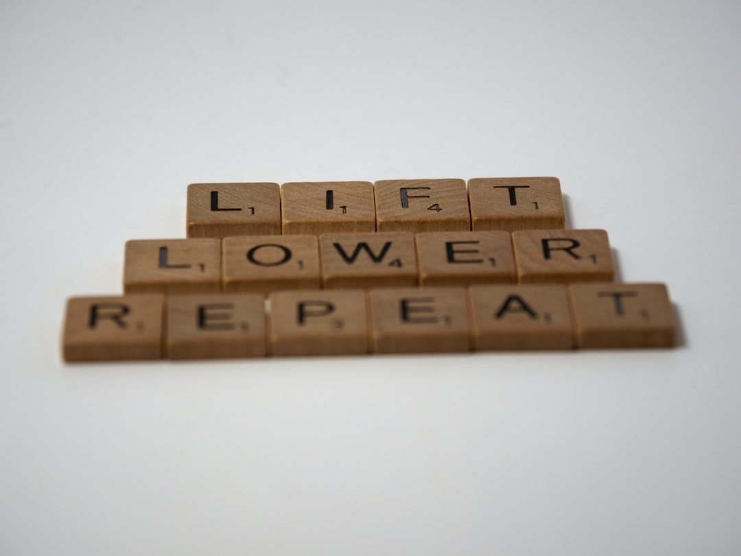 scrabble, scrabble pieces, lettering, letters, white background, wood, scrabble tiles, wood, words, lift, lower, repeat, weight training, pumping iron, fitness training, fitness, weights, barbell, dumbell, persistence, repetition, reps,