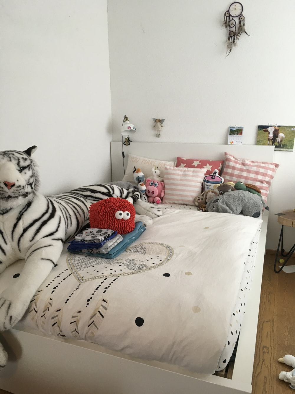 white and black cat on bed
