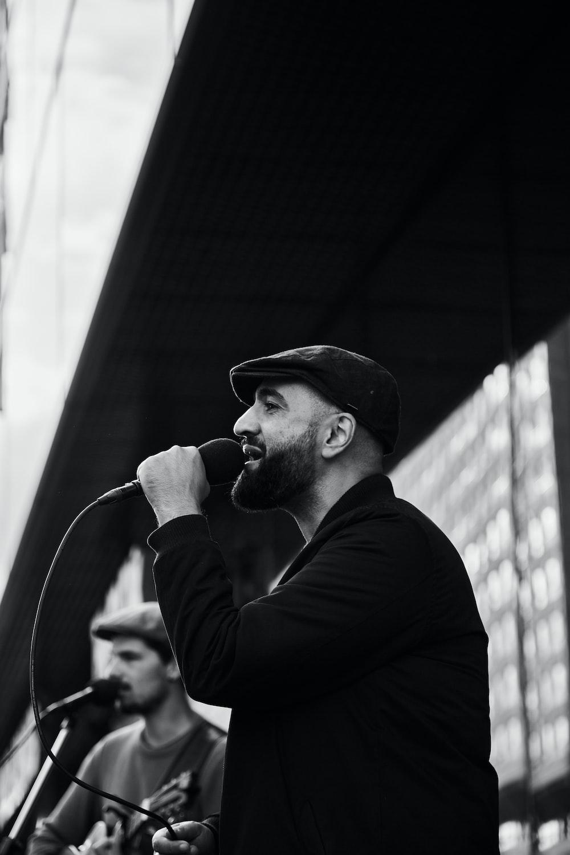 man in black long sleeve shirt singing