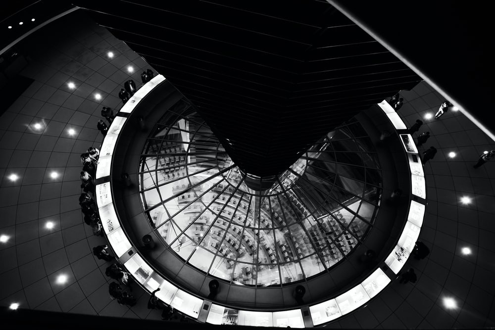 grayscale photo of spiral staircase