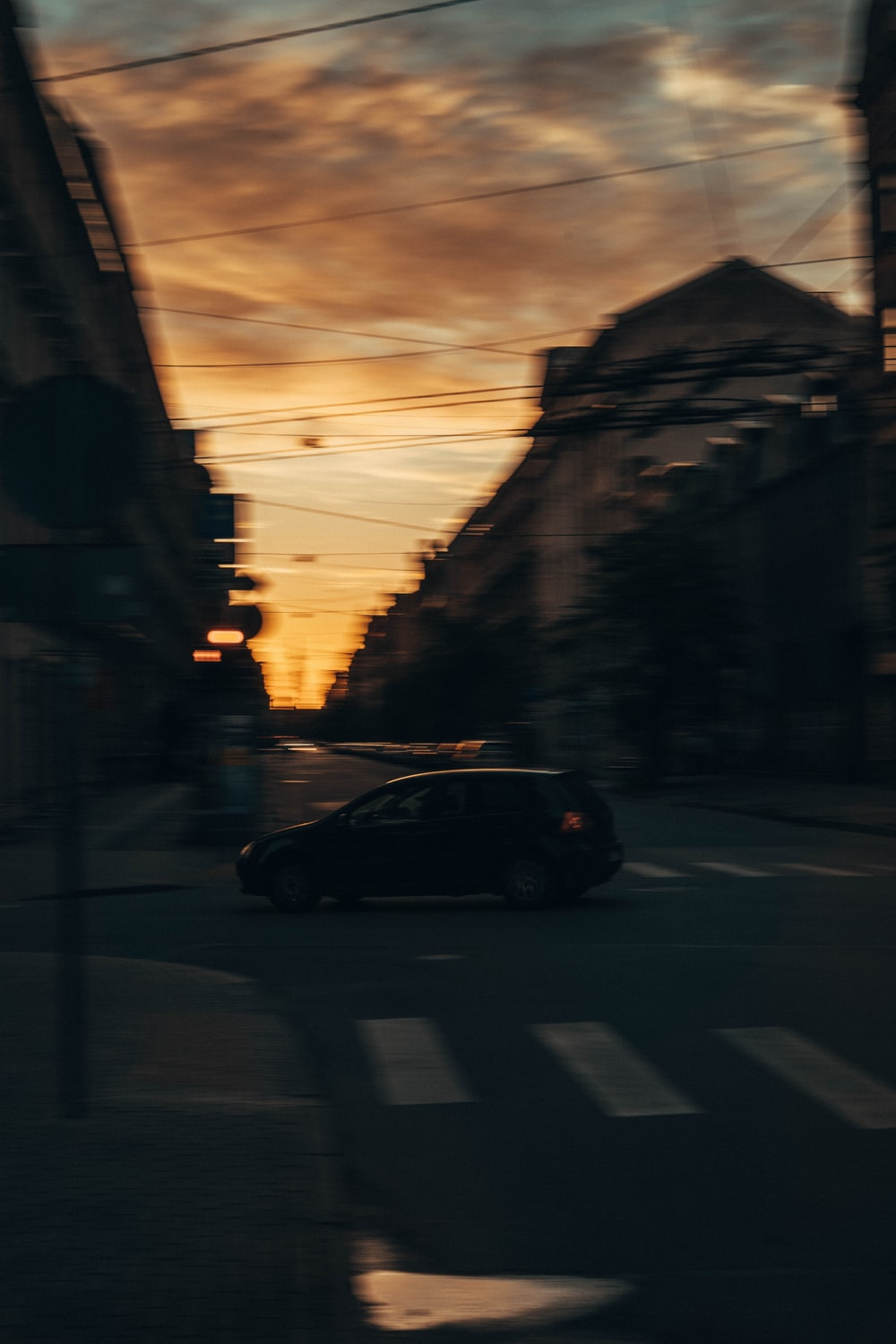 black car on road during sunset