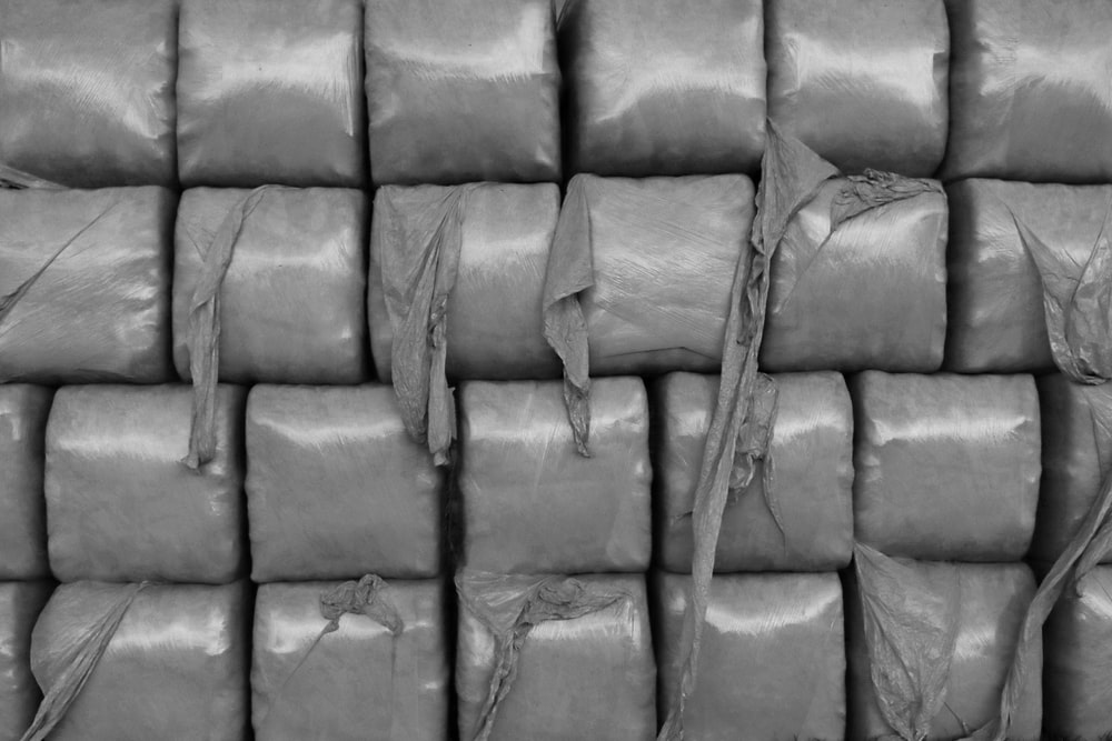 grayscale photo of a leather sofa