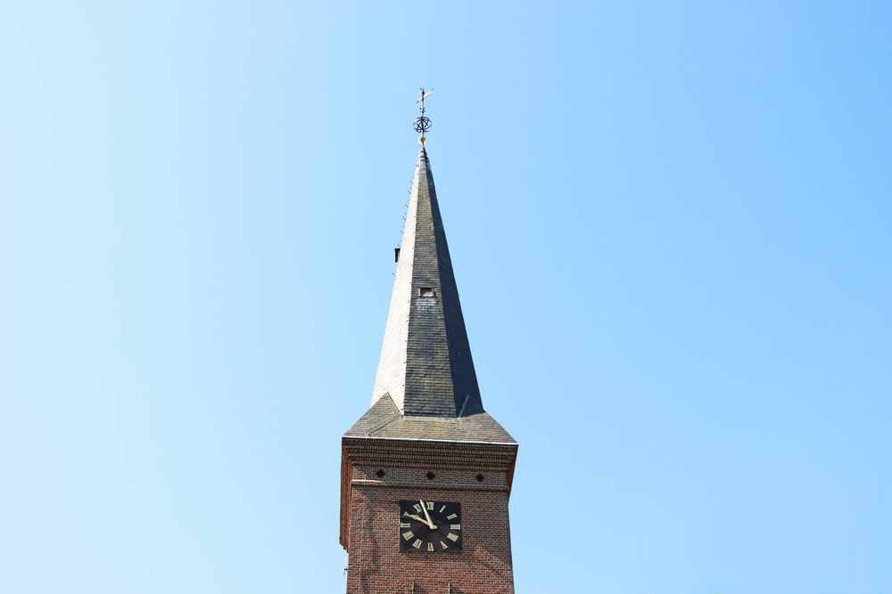 brown concrete tower with clock