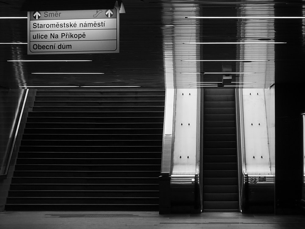 grayscale photo of a roll up door