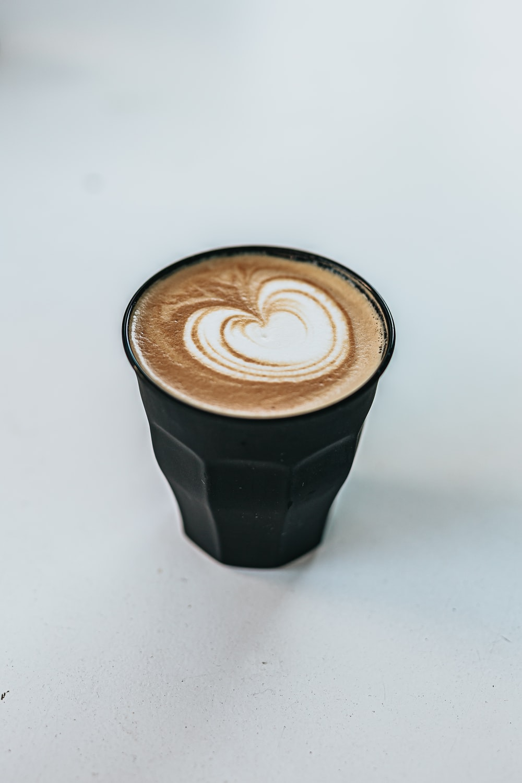 black and white ceramic mug with coffee