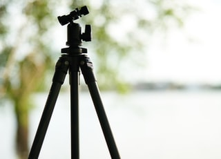 black and blue tripod on brown wooden table